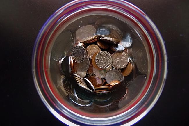 Coins inside a jar.